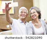 happy asian senior couple... | Shutterstock . vector #542821090