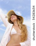 summer: smiling woman with sun hat sunbathing - stock photo