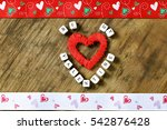 wood background with heart shape | Shutterstock . vector #542876428