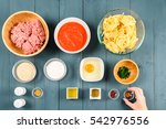 arranging food ingredients on... | Shutterstock . vector #542976556