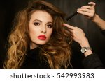 stylist corrects hairstyle... | Shutterstock . vector #542993983