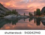 rocks and trees reflecting in... | Shutterstock . vector #543042940