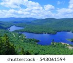 Small photo of Rivière rouge, Mont Tremblant National Park, Laurentian Mountains, Quebec (close to Montreal), Canada. 19 July 2015. Canadian wilderness and beautiful landscape with cloudy sky. mostly green and blue