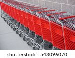 red shopping cart in a row | Shutterstock . vector #543096070