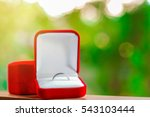 Close Up Wedding Ring In Red...