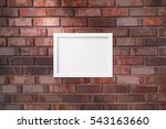 picture frame on a brick wall... | Shutterstock .eps vector #543163660