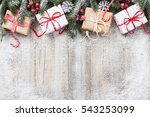 Christmas decoration and gift boxes on wooden background