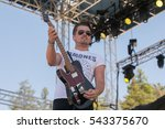 Small photo of Santa Rosa, CA/USA - 6/3/2016: Chase Bryant performs at Country Summer Music Fest. In 2015 his single, Take It On Back, was a top 10 single on Country Airplay, published weekly by Billboard.