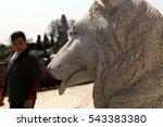 """Small photo of JIANGXI CHINA-Mar31, 2012:people to visit Todd tomb, 9 years ago, Todd """"tiger"""" dead meat saved toxic warning, more than 30 people's lives. Later people will be thick burial, stone sculpture memorial."""