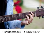 Small photo of Woman finger on guitar play a song with easy chord