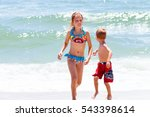 sister and brother in the water ...   Shutterstock . vector #543398614