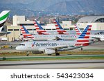 Small photo of LOS ANGELES/CALIFORNIA - DEC. 17, 2016: American Airlines Airbus A319 Airbus taxiing along the runway upon arrival at Los Angeles International Airport, Los Angeles, California USA
