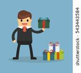 businessman holding a gift box | Shutterstock .eps vector #543443584