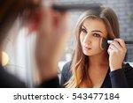 applying makeup carefully | Shutterstock . vector #543477184