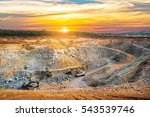 Aerial view of opencast mining quarry with lots of machinery at work - view from above.This area has been mined for copper, silver, gold, and other minerals - stock photo