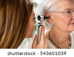 doctor holding otoscope and... | Shutterstock . vector #543601039