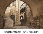 Old city hidden passageway, stone stairway and arch. Jerusalem, Israel