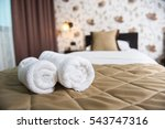 Stock photo towel rolls on a hotel bed 543747316