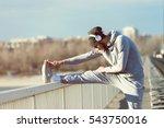 man runner stretching legs... | Shutterstock . vector #543750016