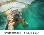 young man ist snorkeling in the ...