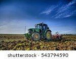 Farm Tractor Preparing The Soi...