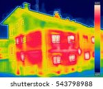 Stock photo infrared thermovision image showing lack of thermal insulation on house with or without facade 543798988