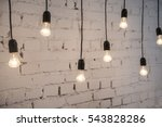 Retro Light Bulbs Hang In...