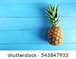 Ripe Pineapple On A Blue Wooden ...