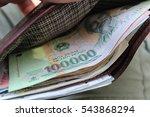 vietnamese dong in a wallet | Shutterstock . vector #543868294