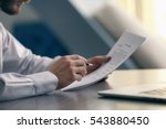 businessman reading documents | Shutterstock . vector #543880450