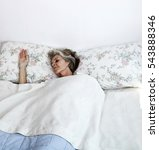 senior woman sleeping in bed at ... | Shutterstock . vector #543888346