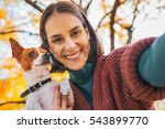 smiling young woman with dog... | Shutterstock . vector #543899770