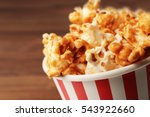 caramel popcorn in striped box...   Shutterstock . vector #543922660