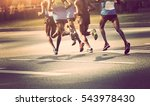 marathon runners running on... | Shutterstock . vector #543978430