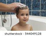 mom's hands washing little... | Shutterstock . vector #544049128