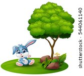 Stock photo cartoon rabbit sitting under a tree on a white background 544061140