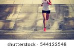 young sporty woman running on... | Shutterstock . vector #544133548