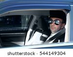 chauffeur driving a car  closeup | Shutterstock . vector #544149304