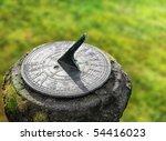 Old sun clock dial in a garden