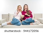 laughing female friends sitting ... | Shutterstock . vector #544172056