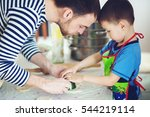 father teaches son to cook. the ... | Shutterstock . vector #544219114