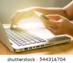 a woman using laptop to... | Shutterstock . vector #544316704