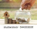 women's hand put money coins in ... | Shutterstock . vector #544333039