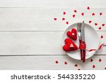 Stock photo festive table setting for valentine s day with fork knife and hearts on a white wooden table 544335220