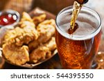 pouring beer into mug with... | Shutterstock . vector #544395550