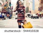 fashionable brunette woman in a ... | Shutterstock . vector #544410328
