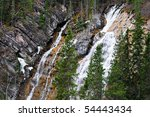 Waterfall In The Forest At...