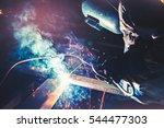 welders working as the industry ... | Shutterstock . vector #544477303
