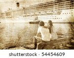 Couple Looking At Cruise Liner...