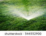sprinklers spraying water on... | Shutterstock . vector #544552900